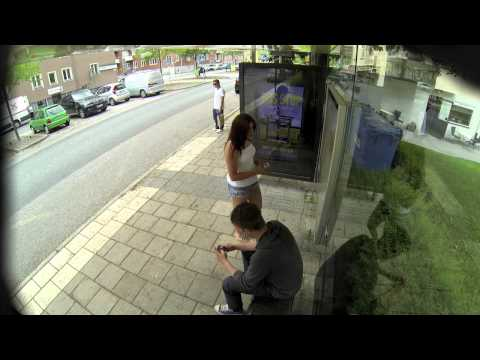 Photoshop artist creates real time ads with people at a bus stop